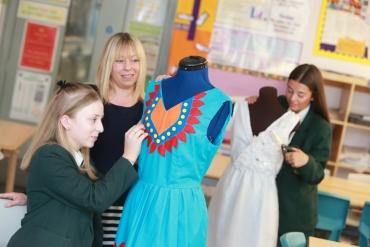 Textiles studetns and teacher